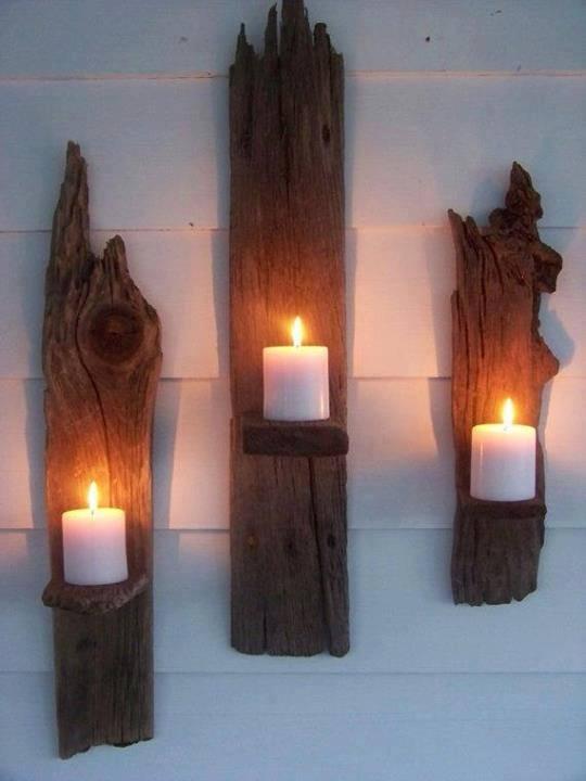 Apliques de pared para velas hechos con madera mojada
